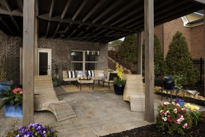 An outdoor oasis at Mabry Manor created with stone pavers, elegant lighting and cozy seating.